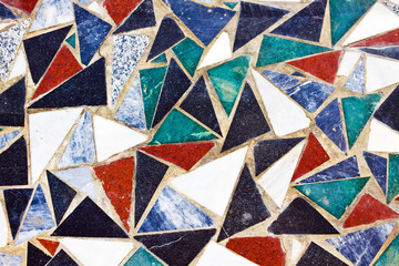 Triangular colorful mosaic texture on wall