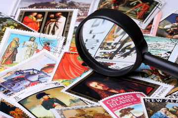 Stamp collection and magnifying glass