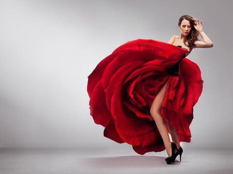 Beautiful young lady wearing red rose dress
