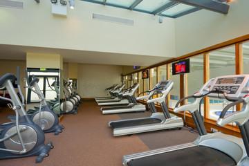 row of jogging simulators in gym