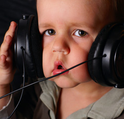 a child's face in the headphones