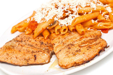 fried salmon with pasta topped with cheese