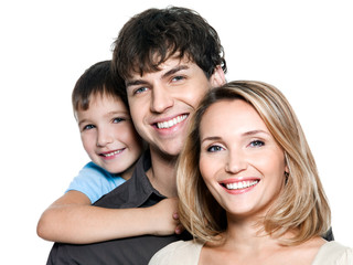 Faces of a happy young family on white background