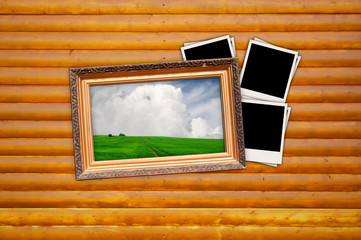 Picture in Vintage Frame with Blank Photos on Wood Background