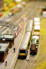 trains in a miniature model railway station