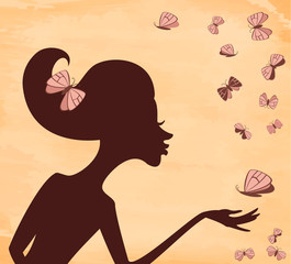 Silhouette of a girl with a butterfly on the background grunge