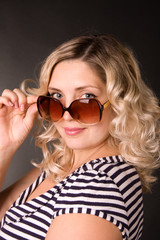 portrait of beautiful young woman of blonde is in sunglasses