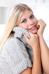 Beautiful blond woman realxing at home in winter