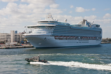 Sheriffs Boat Speeding Past a Luxury Cruise Ship