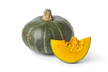 Whole green pumpkin with a slice