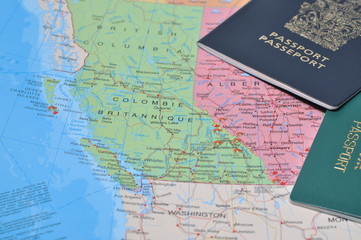 Canada passport with business travel on the map