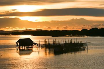 Fisherman lifestyle on sunset at Thailand