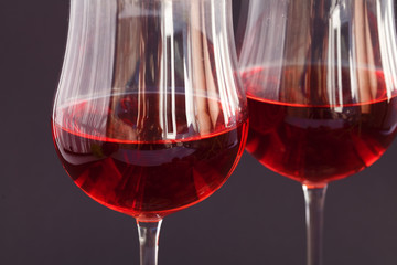 glass of wine on a black background
