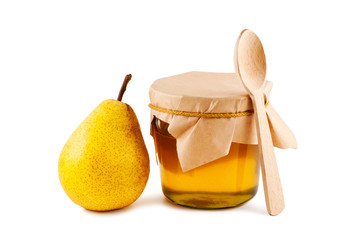 Honey in glass jar, pear, wooden spoon isolated on white backgro