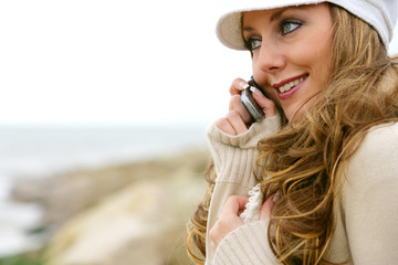 Young Woman Using Mobile Phone. Model Released