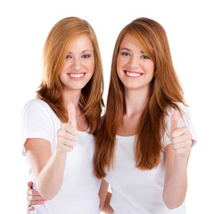 pretty young sisters thumbs up