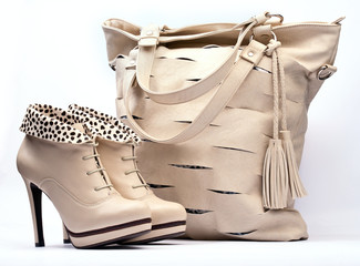 Creamy female boots and leather bag