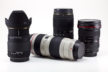 Four photo lenses isolated on the white background