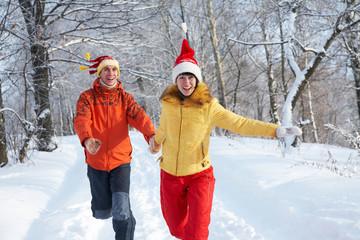 couple running in winter park