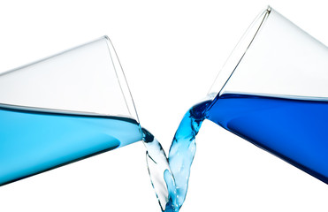 Two glasses spilling water or a similar blue liquid isolated on