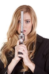 Blond looking around gun