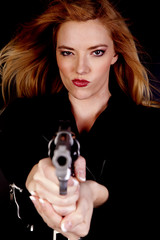 Serious blond with gun
