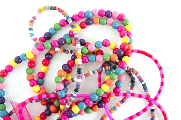 Colorful wood necklaces mess over white