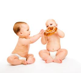 Boys eating bread roll