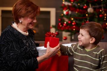 Grandson giving christmas present
