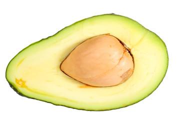 Half avocado with stone isolated on white