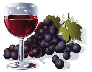 Verre de vin rouge et grappe de raisin noir