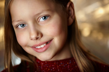 Closeup portrait of attractive smiling little girl