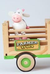 Vache dans camion de Bois