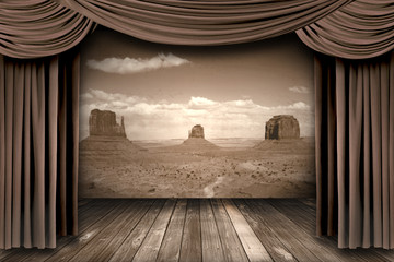 Hanging stage theater curtains with a desert  background