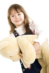 Photo of a little girl holding teddy bear