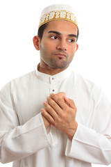 Ethnic man holding his hands to his chest