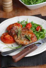 Pork fillet with rocket and cooked tomatoes