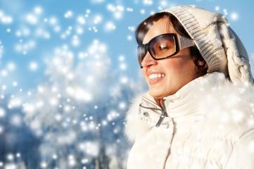 Beautiful young woman enjoying winter day .