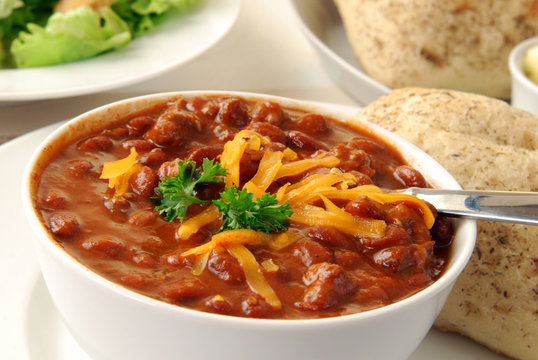 Hot chili with dinner rolls