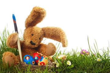 Easter bunny with painted eggs and paintbrush