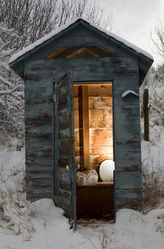 Snowy day outhouse