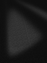 Woven black carbon fibre surface texture vertical