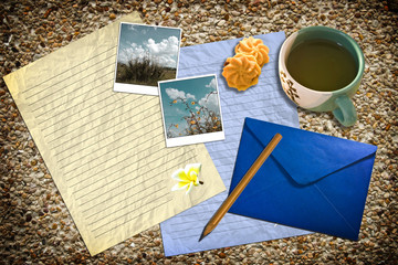 Letter with mail and tea on ground