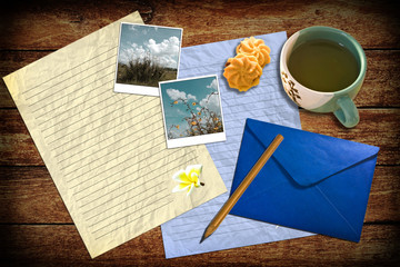 Letter with mail and tea on table