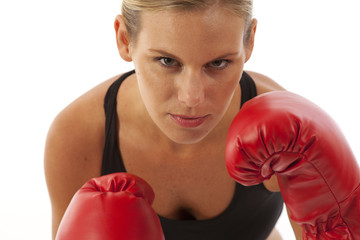 Close up of young woman with red boxing gloves