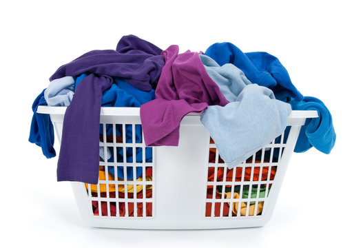Colorful clothes in laundry basket. Blue, indigo, purple.