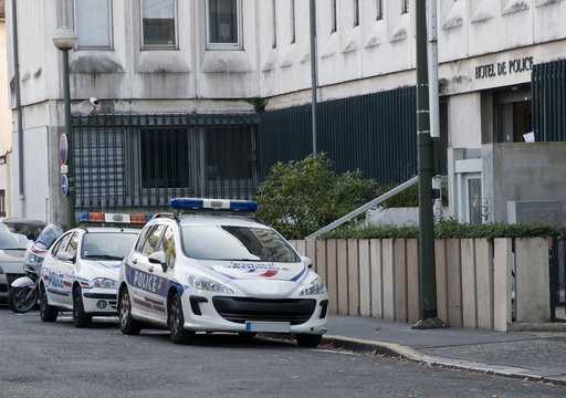 Two french police cars parked in front of police station