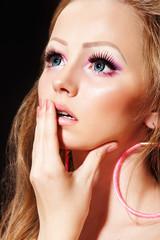 Fashion model with doll make-up, long eyelashes, big blue eyes