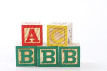 children learning letter blocks