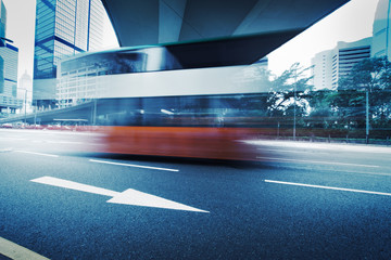 Long exposure photo of bus moving on road. Blurred motion